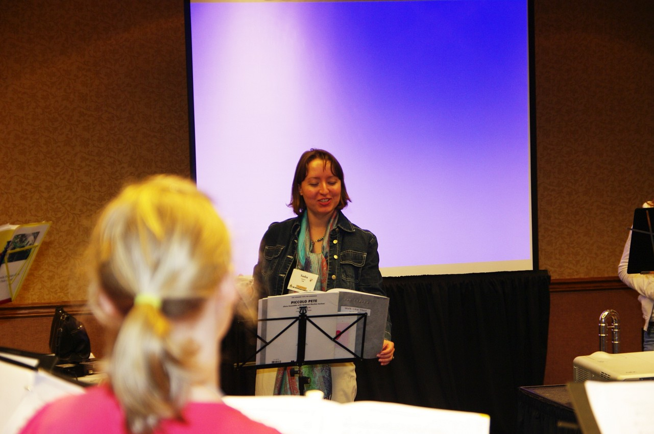 Sasha Garver conducts a Flute Performing Ensemble rehearsal at the 2010 Conference