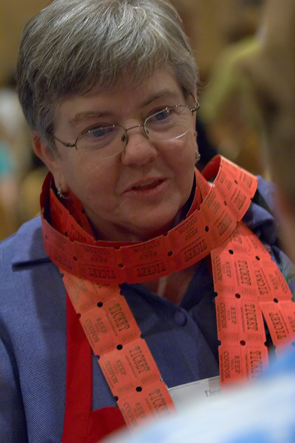Board member Dee Martz covered in raffle tickets at the 2006 SAA Conference