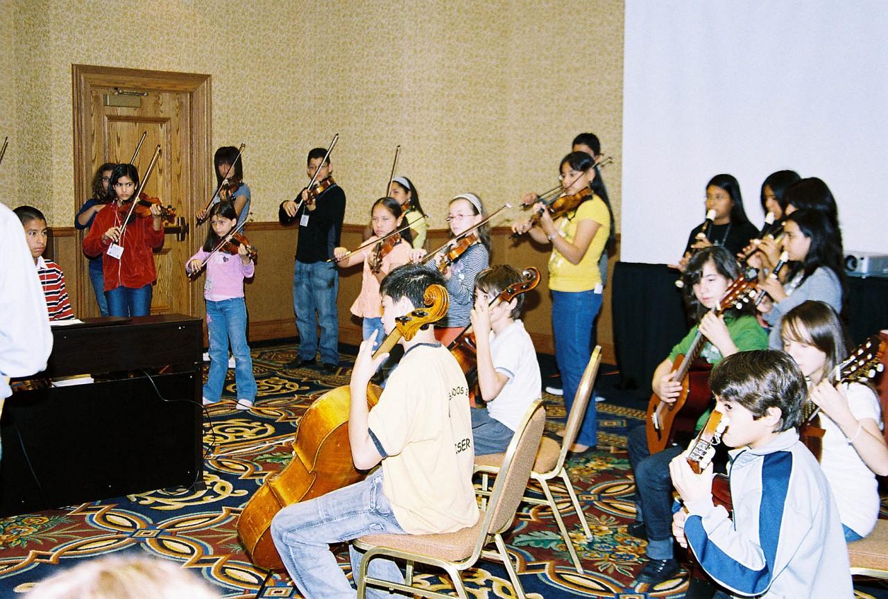 The Latin American Suzuki Ensemble rehearses some more.