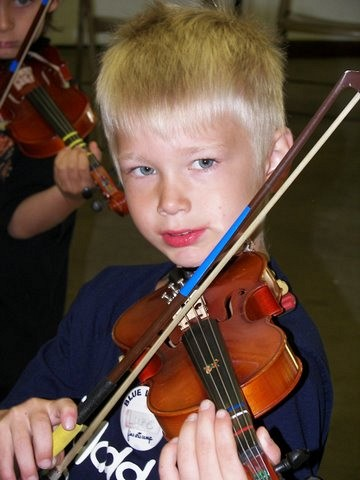Violin student at Blue Lake Suzuki Family Camp