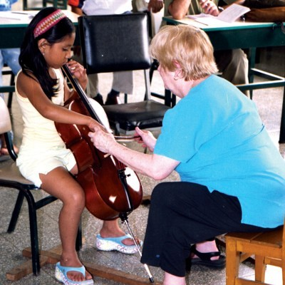 Carol Tarr and young cellist in Peru