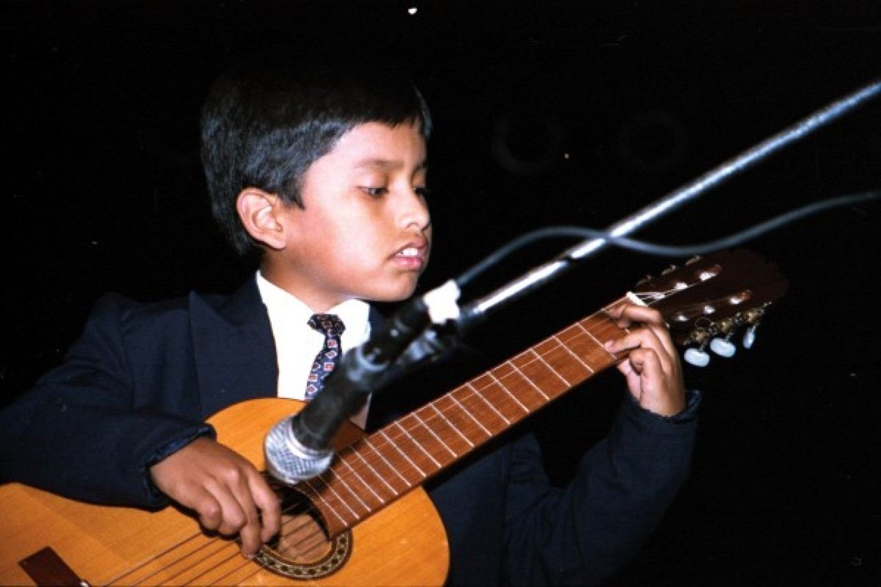 Young guitarist in concert