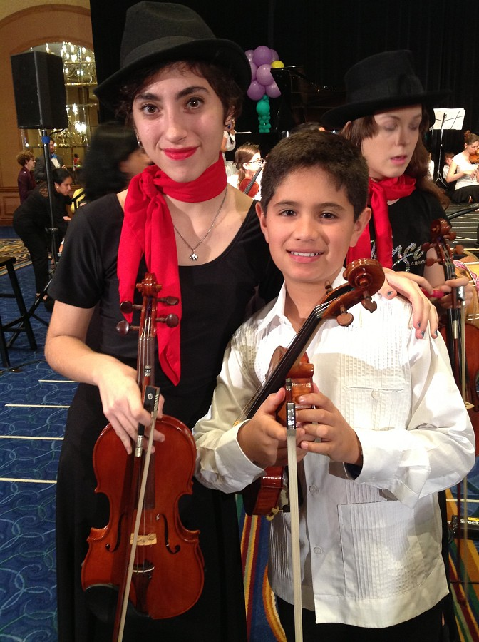 2 students performing with the Latin American Ensemble at the Conference