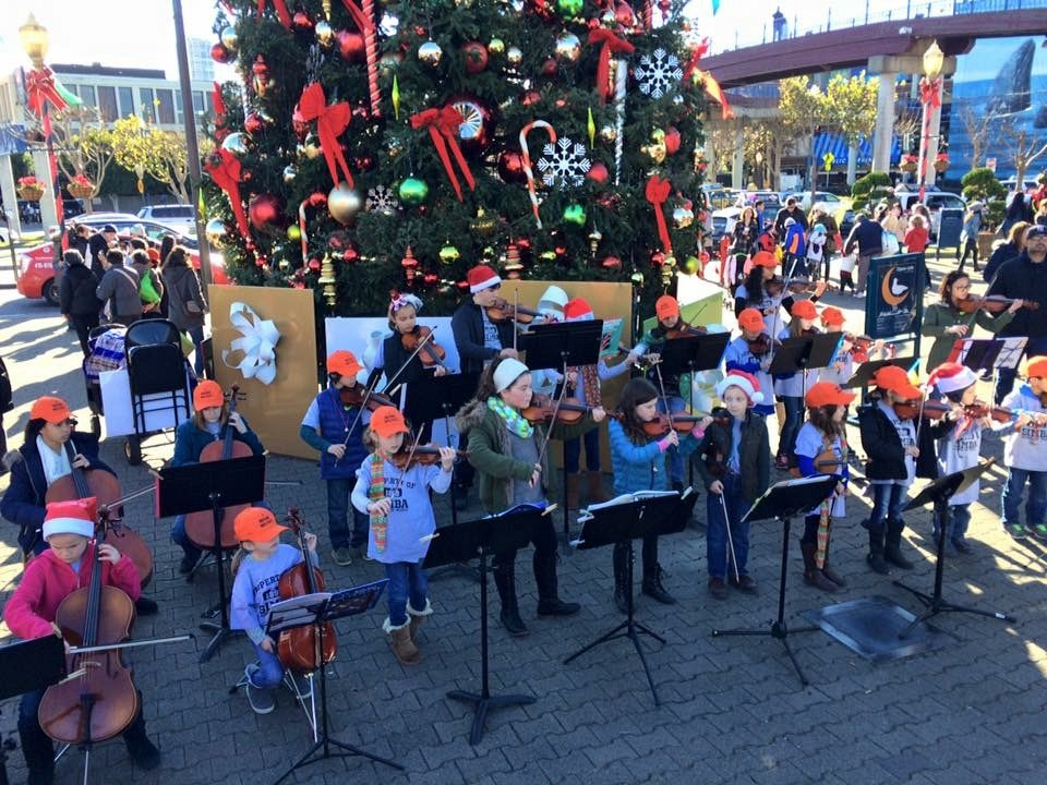 Students of Simba School of Music playing at Pier 39 in SF