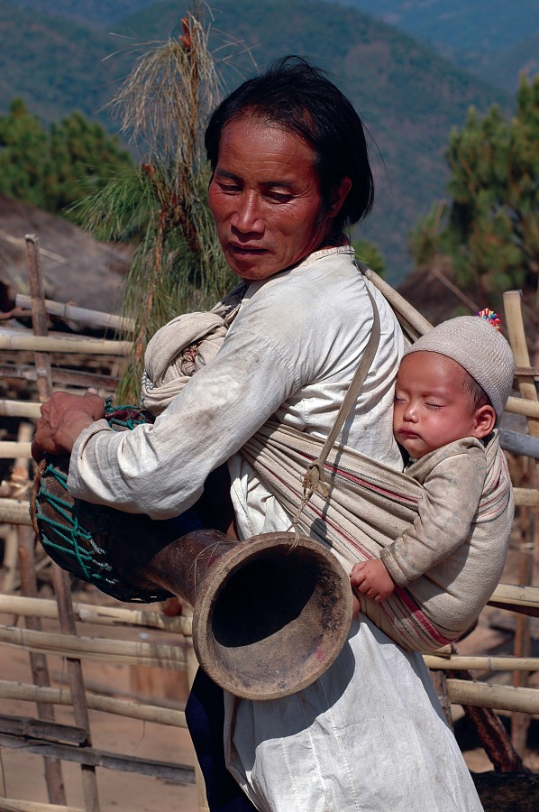 Lahu Shi man and grandchild, Harvest Festival in Keng Tung, Myanmar/Burma, 2005