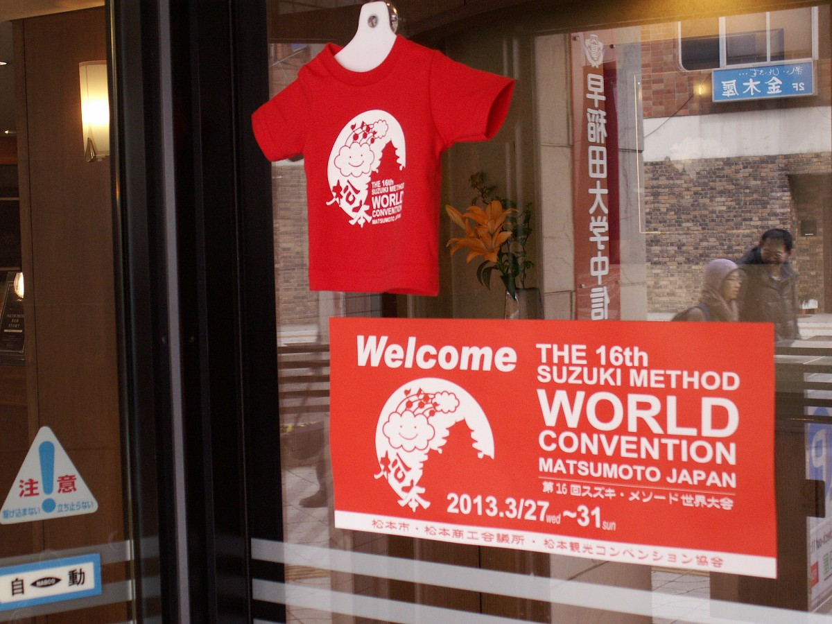Welcome banners in shop windows all over Matsumoto greet convention goers.