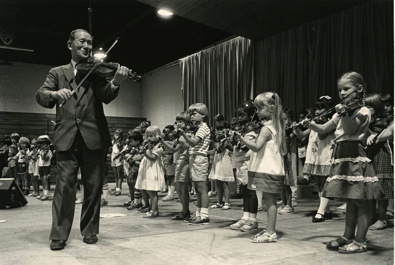 Dr. Shinichi Suzuki Leads a Student Violin Group