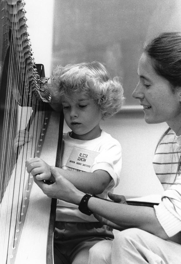 Mary Kay Waddington gives a harp lesson at Intermountain Suzuki Institute