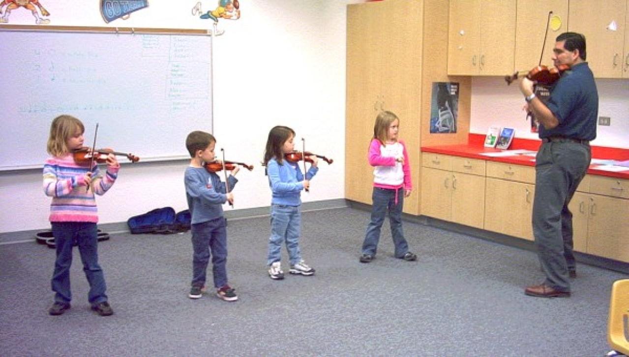 Rigo Murillo with Elementary Class