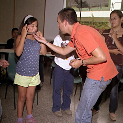 Juan Manuel Acosta and flute student