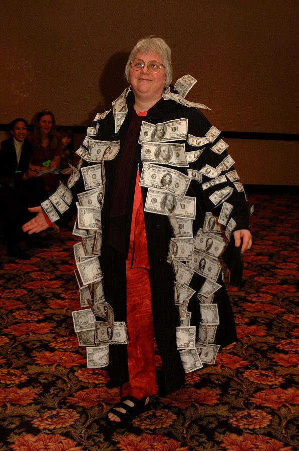 Gilda Barston in the money coat at the 2001 SAA Leadership Retreat.