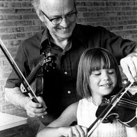 John Kendall in a violin lesson