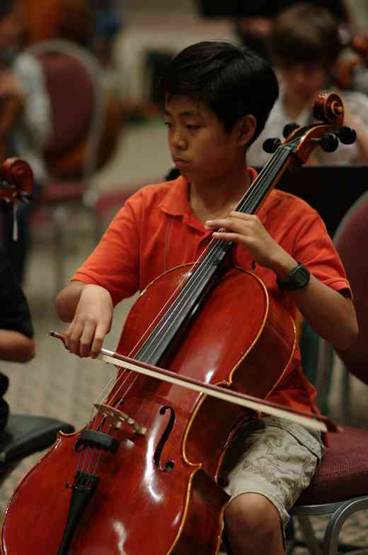 SYOA cellist in rehearsal at the 2012 conference