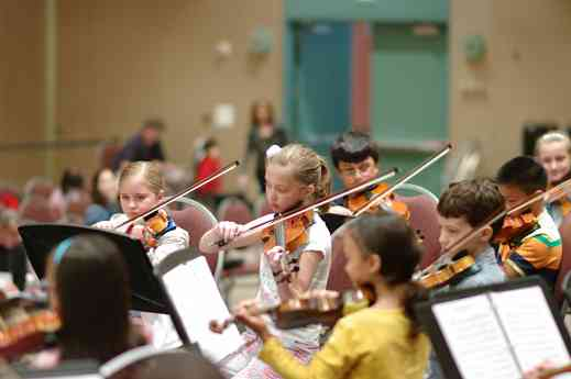 SYOA violinists in rehearsal at the 2012 conference