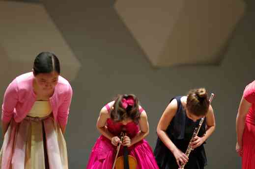 Sarafina Oh, Yesong Sophie Lee, and Nadira Novruzov take a bow in the Kaleidoscope Concert