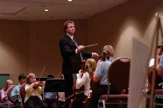 Emmett Drake conducts the SYOA 1 concert at the 2012 conference