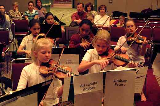 SYOA violin section hard a practice at the 2002 SAA Conference.
