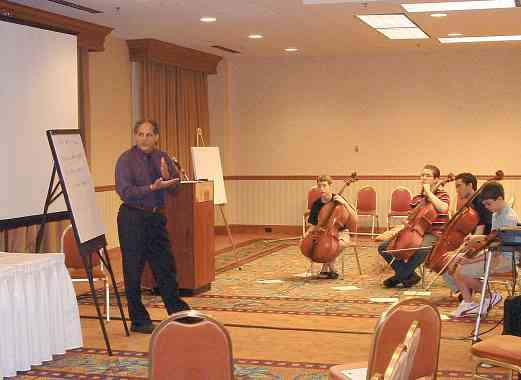 Barry Green in session with high school cellists and bassists at the 2004 SAA Conference