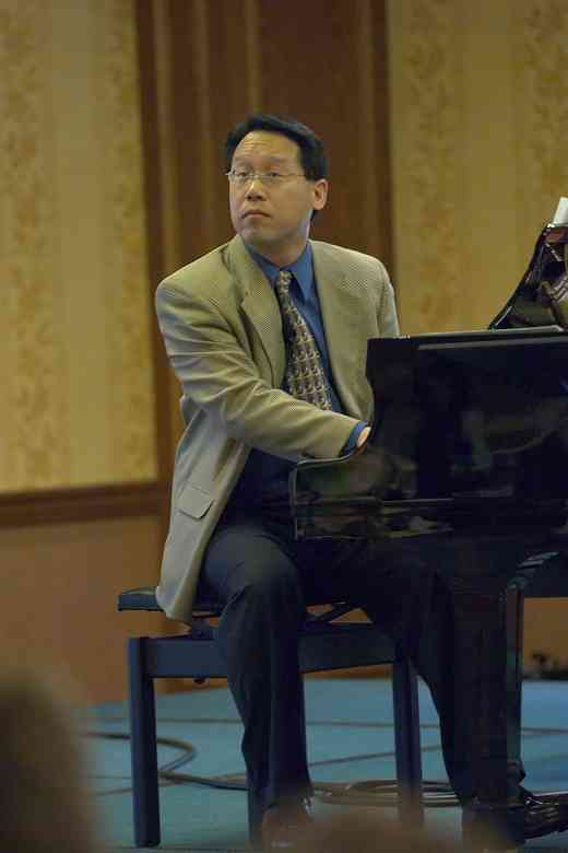 Brian Chung plays the piano at the 2006 SAA Conference