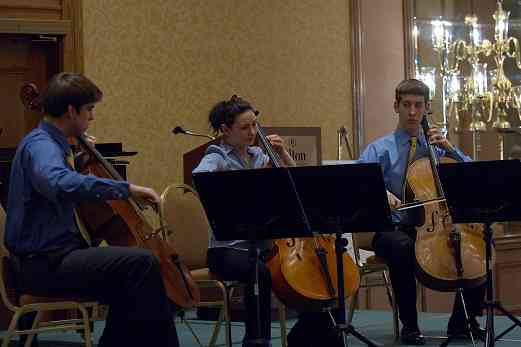 Bryant Hopkins, Olivia Burzynska-Hernandez, and Patrick Hopkins in the cello ensemble masterclass at the 2006 SAA Conference