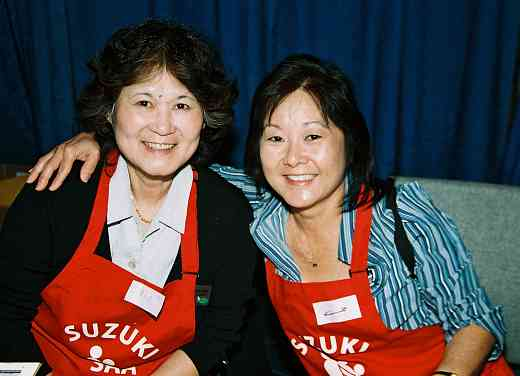 Rosemay Fangyen, convention staff, and Deb Yamashita, SAA staff in their red SAA aprons.