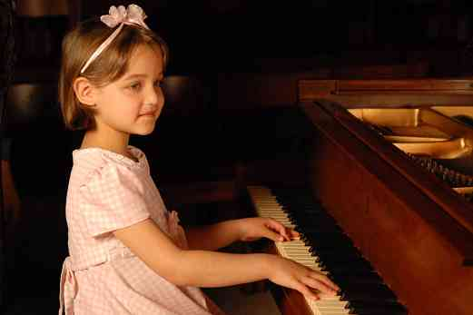 Young girl at the piano at the 2008 SAA Conference