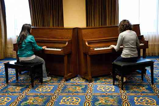 Latin American piano students practice at the 2008 SAA Conference