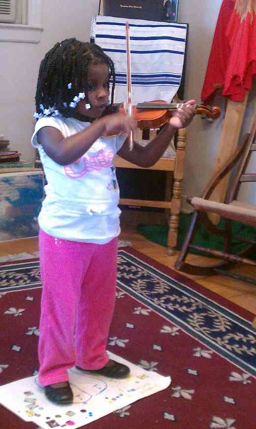 Violin student at Greater New Orleans Summer Suzuki Music Camp