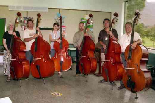 Virginia Dixon and her six double bass trainees
