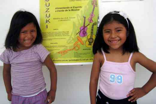 Two cousins with the Peru Festival poster