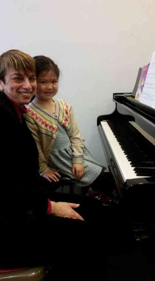 Lisa Sun (6) at the piano lesson