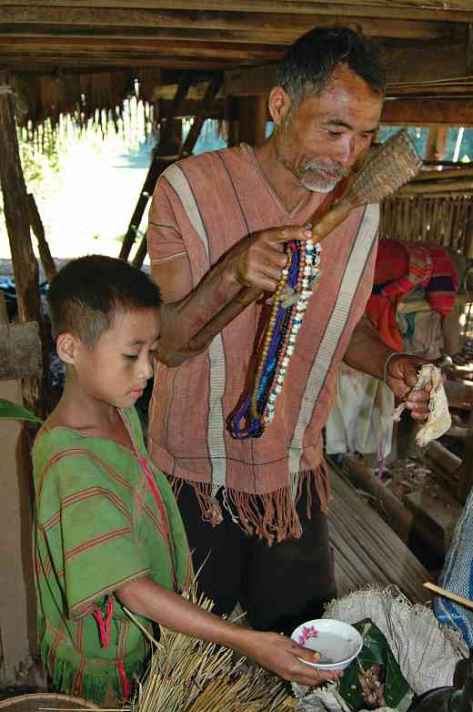Karen father and son harvest ritual, Mae Hong Son, Thailand, 2008