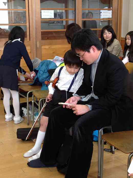 Student from Japan with his father, having a short break during one of Nancy Lokken's classes