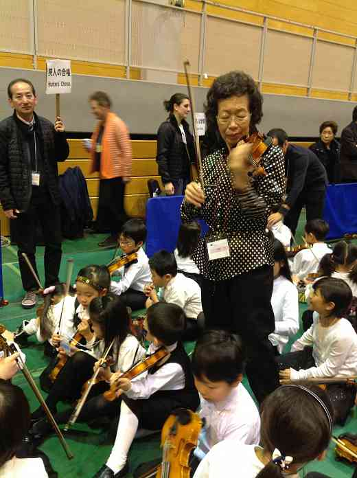 Mihoko Hirata tuning students as they get ready for the Final Concert and Closing Ceremonies
