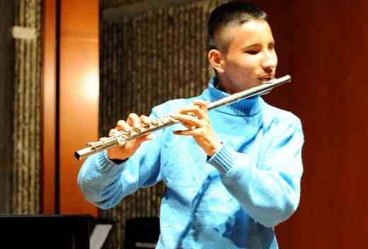 Nicolas playing his new flute