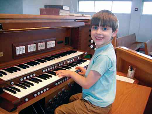 Student Oliver at the organ