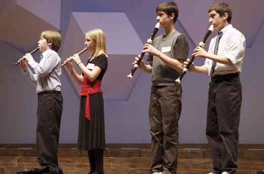 Recorder students perform at the Suzuki Association of Minnesota graduation recital.