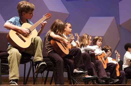 Guitar students perform at the Suzuki Association of Minnesota graduation recital.