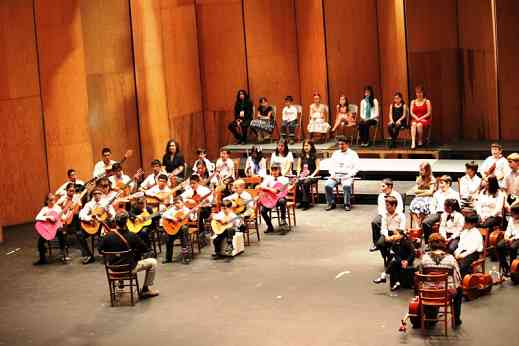 Guitarists perform at the Teatro Juarez