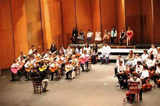 Guitarists perform at the Teatro Juarez