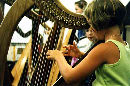 Young harpist as Peaks to Plains Suzuki Institute in 2002