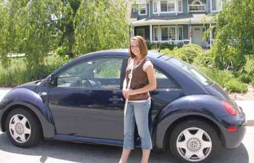 Helen McGarr and her blue Volkswagen Beetle