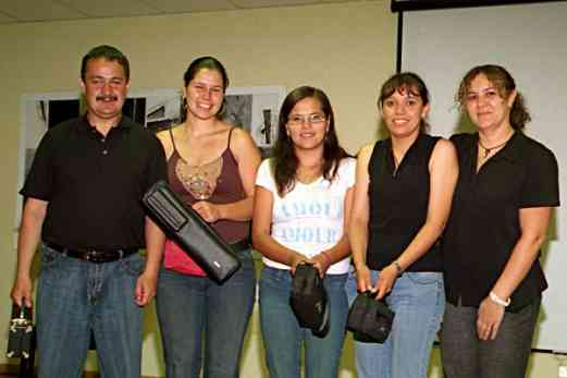 Tarcicio Andrade, Diana Bettin, Winivere Roman, and Claudia Gomez receiving donated flutes. Kelly Williamson at right.