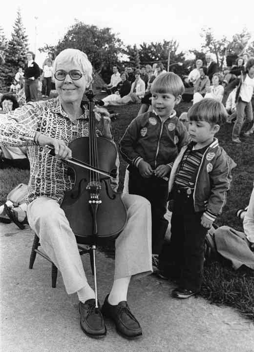 Yvonne Tait demonstrates on a student's cello
