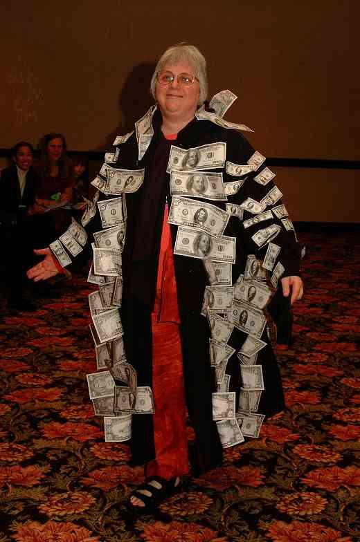 Gilda Barston in the money coat at the 2001 SAA Leadership Retreat.