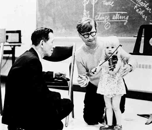 Dr. Shinichi Suzuki and Alfred Garson and with a young violin student