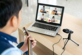 Asian Boy Playing Guitar
