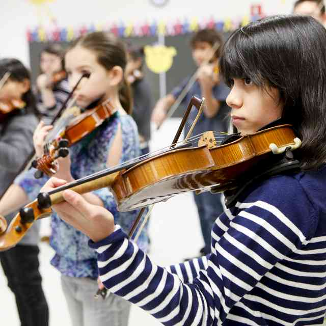From Pilsen to Matsumoto: Members of Merit School of Music's Suzuki-Alegre Strings Ensemble tune up for 16th Suzuki Method World Convention