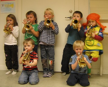 Group of Children Playing Trumpet