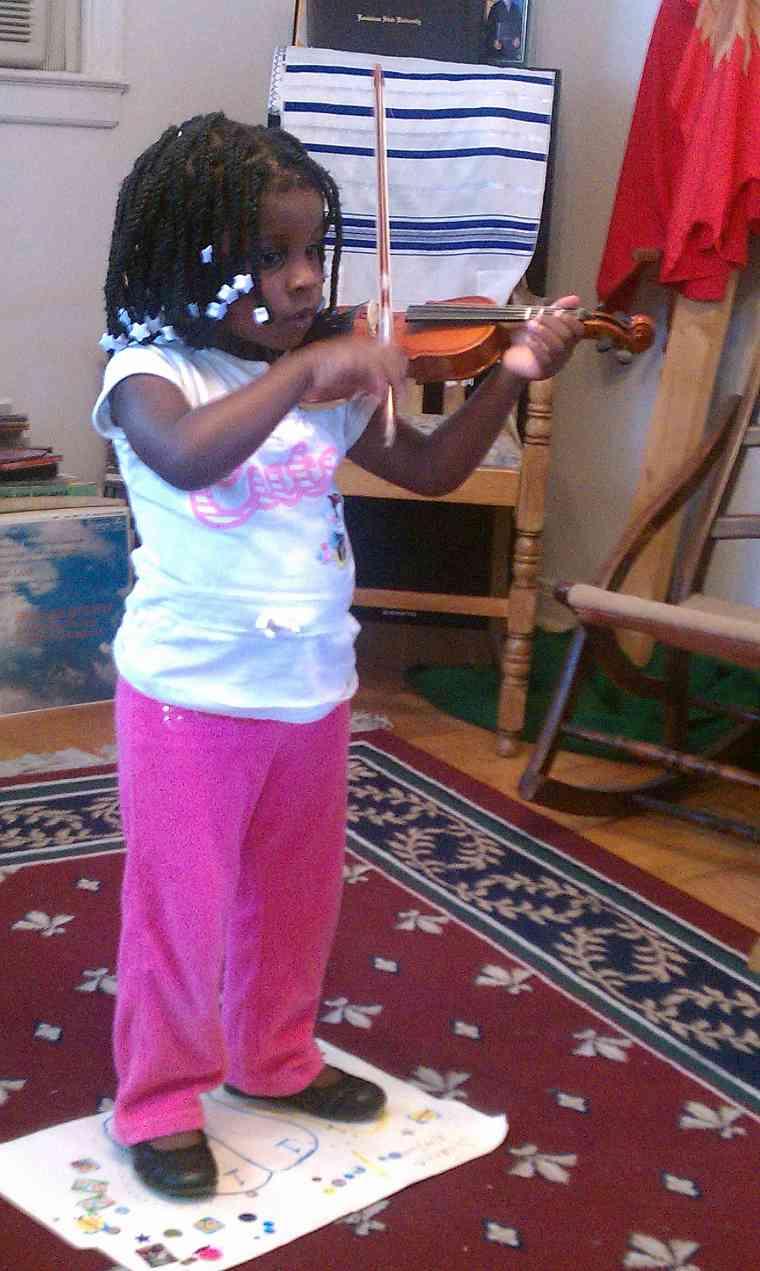 Violin student at Greater New Orleans Summer Suzuki Music Camp
